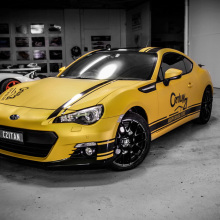 Design & artwork concepts for the Joseph Tan Century 21 Subaru BRZ.  Entirely wrapping vehicle in matt metallic gold with design work laser cut out of gloss black vinyl.